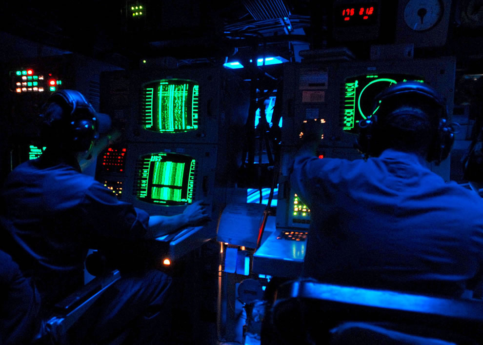 U.S.-Navy-sonar-technicians-aboard-the-guided-missile-destroyer-USS-The-Sullivans-DDG-68-monitor-sonar-equipment-for-marine-mammals-or-submarine-activity-during-the-Southeastern-Anti-Submarine-Warfare