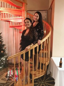 girls pose on stairway